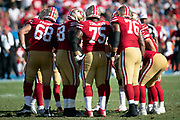 The San Francisco 49ers offense huddles and calls a play during the NFL week 4 regular season football game against the Los Angeles Chargers on Sunday, Sept. 30, 2018 in Carson, Calif. The Chargers won the game 29-27. (©Paul Anthony Spinelli)
