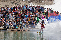 """""""Cushing Classic at Squaw Valley 7"""" - Photograph of a skier crossing a pond during the Cushing Classic at Squaw Valley, USA."""