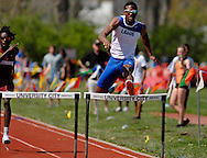 9 APRIL 2011 -- UNIVERSITY CITY, Mo. -- Ladue HIgh School runner Jehu Chesson II (right) crosses the final hurdle en route to the finish line during the boys' 300 meter hurdles at the Charlie Beck Invitational track meet at University City High School in University City, Mo. Saturday, April 9, 2011. Chesson won the event. Image (c) copyright 2011 Sid Hastings.