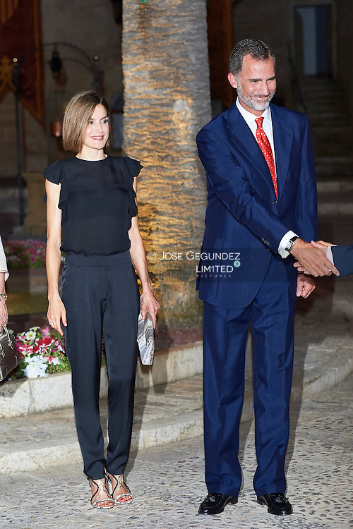 King Felipe VI of Spain and Queen Letizia of Spain attends a official reception at the Almudaina Palace on August 5, 2015 in Palma de Mallorca, Spain.