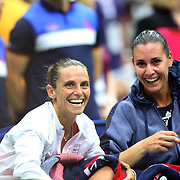 Flavia Pennetta, (right), with, Roberta Vinci Italy, at the trophy presentation after the Women's Singles Final match during the US Open Tennis Tournament, Flushing, New York, USA. 12th September 2015. Photo Tim Clayton