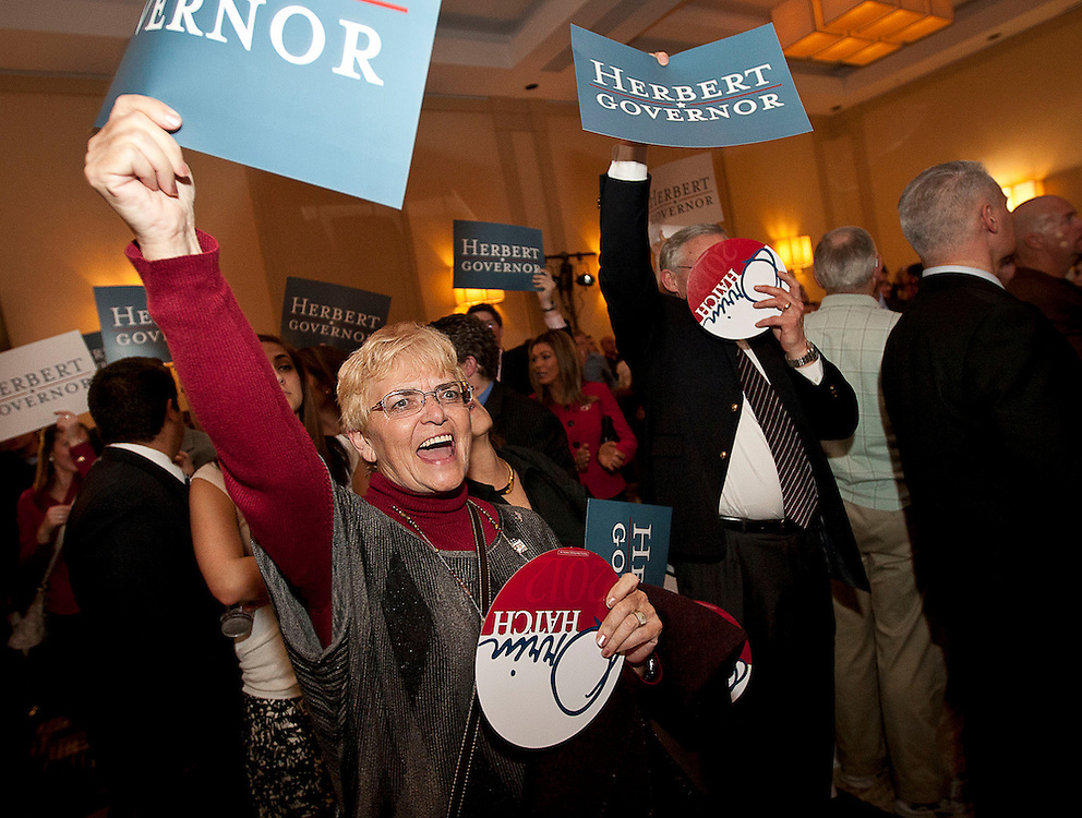 Elke Phillips, left, cheers Gov. Gary Herbert's arrival at the Utah Republican Party results party, Tuesday, Nov. 6, 2012.