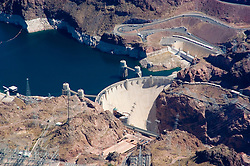 Aerial of Colorado River and Hoover Dam on border of Arizona, AZ, Nevada, NV, water source, flood control, landscape, engineering feat, image nv439-18737.Photo copyright: Lee Foster, www.fostertravel.com, lee@fostertravel.com, 510-549-2202