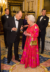 The Queen Elizabeth II and the Aga Khan in the White Drawing Room at Windsor Castle, during a reception before a private dinner to mark the diamond jubilee of the Aga Khan's leadership as Imam of the Shia Ismaili Muslim Community.