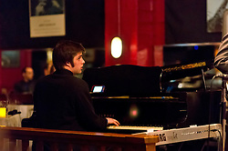 Tyler Peterson at the piano with the PLU Jazz Ensemble at Tula's Jazz Club in Seattle on Sunday, May 3, 2015. (Photo: John Froschauer/PLU)