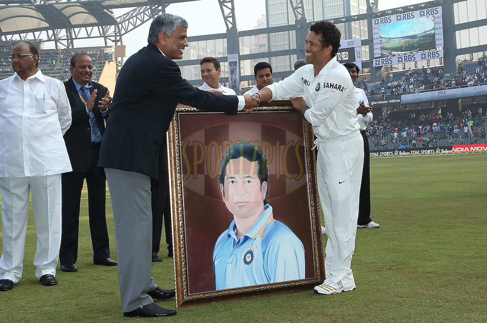 Sachin Tendulkar of India receives a portrait to celebrate his 200th test during day one of the second Star Sports test match between India and The West Indies held at The Wankhede Stadium in Mumbai, India on the 14th November 2013<br /> <br /> This test match is the 200th test match for Sachin Tendulkar and his last for India.  After a career spanning more than 24yrs Sachin is retiring from cricket and this test match is his last appearance on the field of play.<br /> <br /> <br /> Photo by: Ron Gaunt - BCCI - SPORTZPICS<br /> <br /> Use of this image is subject to the terms and conditions as outlined by the BCCI. These terms can be found by following this link:<br /> <br /> http://sportzpics.photoshelter.com/gallery/BCCI-Image-Terms/G0000ahUVIIEBQ84/C0000whs75.ajndY