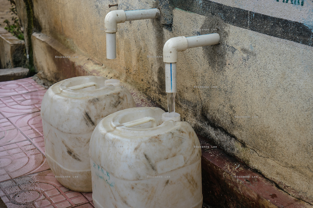 Plastic can stand under taps at a Safe Water Network iJal station in village Gorikothapally, Telangana, Indiia, on Friday, February 8, 2019. Photographer: Suzanne Lee for Safe Water Network
