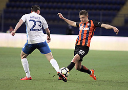 April 18, 2018 - Kharkiv, Ukraine - Defender Oleksandr Nasonov (L) of FC Mariupol and defender Mykola Matviienko (R) of FC Shakhtar Donetsk are seen in action during the Ukrainian Cup semi-final match at the Metalist Stadium in Kharkiv, northeastern Ukraine, April 18, 2018. .Ukrinform..KHARKIV. FC Shakhtar Donetsk has scored impressive five goals in the Ukrainian Cup semi-final match against FC Mariupol at the Metalist Stadium in Kharkiv. Pitmen's midfielder Taison earned two goals (8, 45+2) while his teammates, midfielder Marlos (38), forward Olarenwaju Kayode (74) and midfielder Ivan Petriak (81) added one goal each. Midfielder Ihor Tyshchenko managed to respond on the 22nd minute planting Mariupol's only ball. (Credit Image: © Viacheslav Madiievvskyi/Ukrinform via ZUMA Wire)