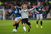 Blackburn Rover's defender Ryan Nyambe holds off a challenge from Derby County's Louie Sibley during the EFL Sky Bet Championship match between Derby County and Blackburn Rovers at the Pride Park, Derby, England on 8 March 2020.