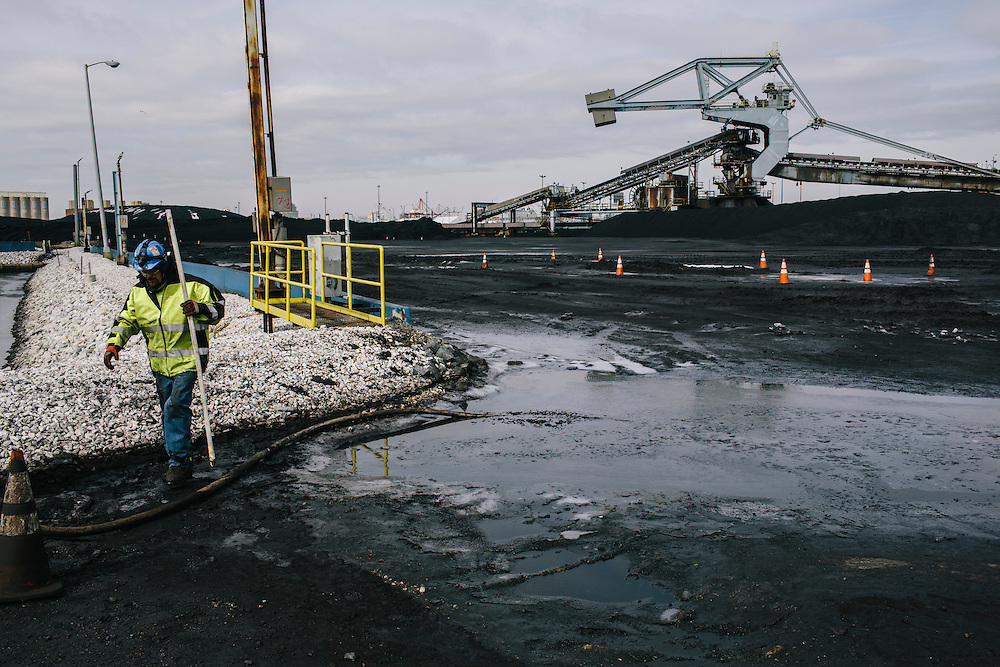 Nick Gainey finishes taking water samples from the outfall pond at Consol Energy's Baltimore Terminal in Maryland on March 6, 2014. Gainey has to test water to make sure it is clear of any hazard before it leaves the terminal.