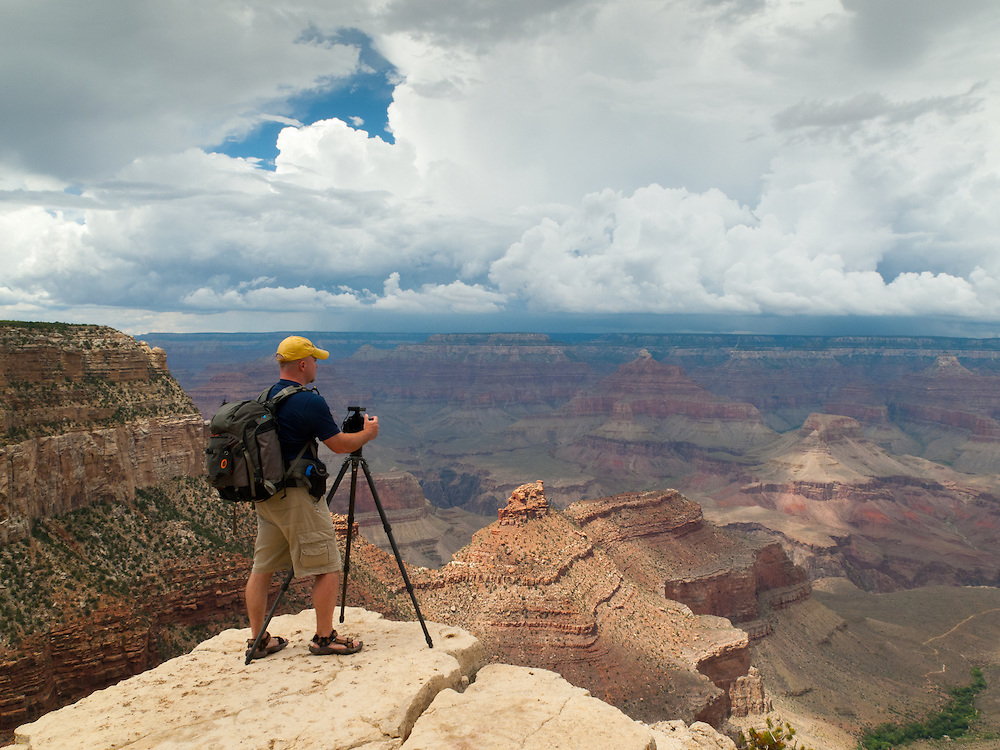 Photographer Adam Schallau photographing the summer monsoon from the South Rim of Grand Canyon National Park where he was an Artist-in-Residence for the National Park. Adam is using a  'Pro Trekker 300 AW' camera backpack by Lowepro.