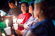 "Sept. 19 - PHOENIX, AZ: People gather for a candlelight vigil in support of the DREAM Act in front Sen. John McCain's office in Phoenix Sunday night. About 30 people met in front of US Sen. John McCain's office in Phoenix Sunday night to demonstrate in support of the DREAM Act, which is scheduled to be debated in the US Senate on Tuesday, Sept 21. The Development, Relief and Education for Alien Minors Act (The ""DREAM Act"") is a piece of proposed federal legislation in the United States that was introduced in the United States Senate, and the United States House of Representatives on March 26, 2009. This bill would provide certain illegal immigrant students who graduate from US high schools, who are of good moral character, arrived in the U.S. as minors, and have been in the country continuously for at least five years prior to the bill's enactment, the opportunity to earn conditional permanent residency. In the early part of this decade McCain supported legislation similar to the DREAM Act, but his position on immigration has hardened in the last two years and he no longer supports it. The protesters, mostly area students, marched and drilled to show their support for the US military and then held a candle light vigil.   Photo by Jack Kurtz"