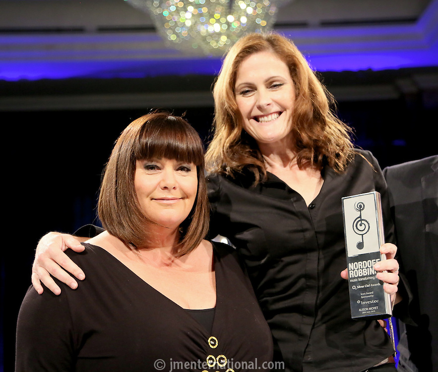 (L-R) Dawn French, Alison Moyet. The Silver Clef Lunch 2013 in aid of  Nordoff Robbins held at the London Hilton, Park Lane, London.<br /> Friday, June 28, 2013 (Photo/John Marshall JME)