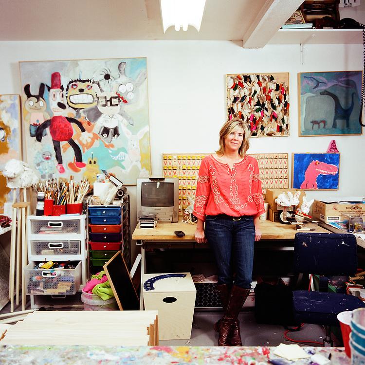 ANCHORAGE, ALASKA - 2012: Artist Julie Decker in her studio.