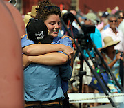Shipwrights Evelyn Ansel, right, and Maggie Wright embrace as Mystic Seaport launches the historic whaleship Charles W. Morgan into the waters of the Mystic River Sunday July 21, 2013 at the seaport's H.B. duPont Preservation Shipyard. The launch takes place in the 172nd anniversary of the ship's original launch in 1841 in New Bedford, Massachusetts. The Morgan, the last remaining wooden whaling ship remaining and the oldest American commercial vessel still in existence as well as a National Historic Landmark, is slated to embark on its 38th voyage, a tour of historic New England ports, in the spring and summer of 2014.  (Sean D. Elliot/The Day)