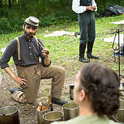 Luke Clawson, of Wilmington, Delaware, acts as a living historian at a Confederate encampment, during the Sesquicentennial Anniversary of the Battle of Gettysburg, Pennsylvania on Wednesday, July 3, 2013.  The Battle of Gettysburg lasted from July 1-3, 1863 resulting in over 50,000 soldiers killed, wounded or missing.  John Boal Photography