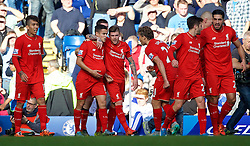 LONDON, ENGLAND - Saturday, October 31, 2015: Liverpool's Philippe Coutinho Correia celebrates scoring the first equalising goal against Chelsea with team-mate Alberto Moreno during the Premier League match at Stamford Bridge. (Pic by Lexie Lin/Propaganda)