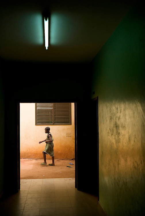 A boy walking outside a house in Benin on February 23, 2008.