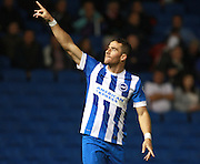 Brighton striker Tomer Hemed salutes the crowd after opening the scoring during the Sky Bet Championship match between Brighton and Hove Albion and Rotherham United at the American Express Community Stadium, Brighton and Hove, England on 15 September 2015. Photo by Bennett Dean.
