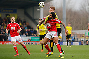 Burton Albion striker Cauley Woodrow (12) battles for possession with Nottingham Forest defender Armand Traore (6) during the EFL Sky Bet Championship match between Burton Albion and Nottingham Forest at the Pirelli Stadium, Burton upon Trent, England on 11 March 2017. Photo by Richard Holmes.