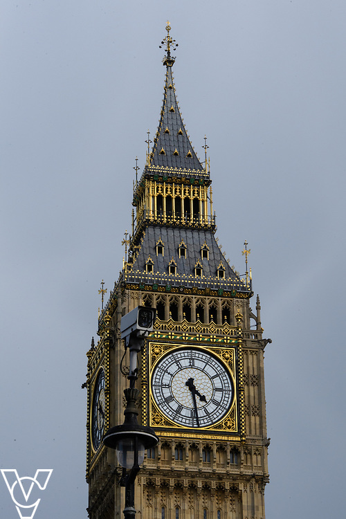 Stock photograph:<br /> <br /> The clock face on the Elizabeth Tower, commonly called Big Ben, seen with a closed circuit television camera (CCTV) in the foreground<br /> <br /> House of Parliament, Big Ben, Parliament, Government, London, Westminster, Elizabeth Tower, clock, clock tower, House of Commons, The Palace of Westminster, grey sky, clouds, closed circuit television camera, CCTV, security, safety<br /> <br /> Picture: Chris Vaughan/Chris Vaughan Photography<br /> Date: April 26, 2017