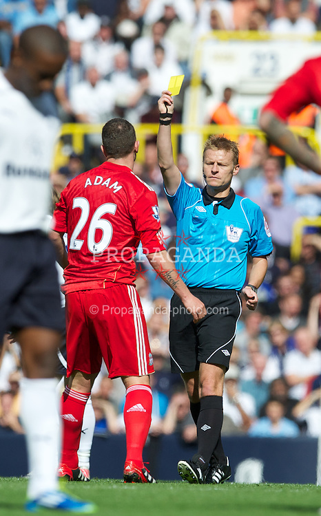 LONDON, ENGLAND - Sunday, September 18, 2011: Liverpool's Charlie Adam is shown the first yellow card by referee Mike Jones during the Premiership match against Tottenham Hotspur at White Hart Lane. (Pic by David Rawcliffe/Propaganda)