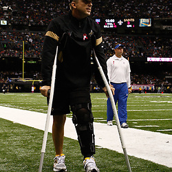 October 23, 2011; New Orleans, LA, USA; New Orleans Saints head coach Sean Payton leaves the field on crutches prior to kickoff of a game against the Indianapolis Colts at the Mercedes-Benz Superdome. Mandatory Credit: Derick E. Hingle-US PRESSWIRE / © Derick E. Hingle 2011