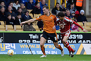 Wolverhampton Wanderers midfielder Kevin McDonald and Middlesbrough striker Diego Fabbrini battle for the ball during the Sky Bet Championship match between Wolverhampton Wanderers and Middlesbrough at Molineux, Wolverhampton, England on 24 October 2015. Photo by Alan Franklin.