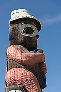 Traditional Native American totem pole outside the Alaska Railroad depot in downtown Anchorage, Alaska.