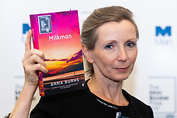 Man Booker Prize winner Anna Burns  poses with her novel Milkman at a press conference following the award at the Guildhall in London. Guildhall, London, October 16 2018.