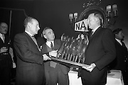 05/04/1966<br /> 04/05/1966<br /> 05 April 1966<br /> Presentation Awards for entries in the N.A.I.D.A. Parade at the Shelbourne Hotel, Dublin. Photo shows  Mr. L.V. Nolan, (left) President of the N.A.I.D.A. presenting the major award (Coras Iopmair Eireann Premier Award) to Mr. Aidan Creedon, managing Director, Gypsum Industries Ltd. and Aodhagan Brioscu, B. Arch., Marketing Manager, Gypsum (centre).