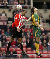 Photo. Glyn Thomas.<br /> Sunderland v West Bromwich Albion. <br /> Nationwide Division 1. 18/04/2004.<br /> Sunderland's Jeff Whitley (L) fights an aerial battle for possession with Sean Gregan.