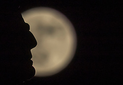 The first Super Moon of 2018 is also a Wolf Moon, so called because it occurs at the time of year when wolves would be heard howling in the mountains. The moon rises above Edinburgh and is silhouetted by the distinctive shape of the Admiral Wellington statue on the city's Princes Street.