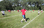 Alden Betzer, 17, senior, warms up with the rest of the team during the first day of football practice at Central City High School in Central City on Wednesday afternoon, August 3, 2011.