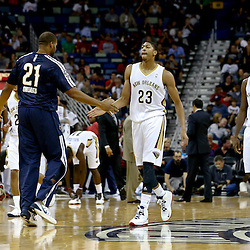 Oct 23, 2013; New Orleans, LA, USA; New Orleans Pelicans power forward Anthony Davis (23) celebrates with teammates during the first half of a preseason game against the Miami Heat at New Orleans Arena. Mandatory Credit: Derick E. Hingle-USA TODAY Sports