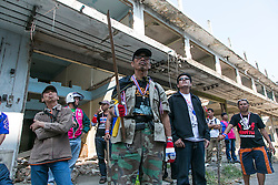 © Licensed to London News Pictures. 17/01/2014. A group of anti-government protestors in an abandoned apartment complex look out for a suspect whom threw an explosive device injuring eight people during an anti-government street rally on January 17, 2014 in Bangkok, Thailand. Anti-government protesters launch 'Bangkok Shutdown', blocking major intersections in the heart of the capital, as part of their bid to oust the government of Prime Minister Yingluck Shinawatra ahead of elections scheduled to take place on February 2. Photo credit : Asanka Brendon Ratnayake/LNP