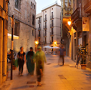 People walking in the narrow streets of the old town or Casc Antic of Tortosa, Tarragona, Spain. Tortosa is an ancient town situated on the Ebro Delta which has a rich heritage dating from Roman times. Picture by Manuel Cohen