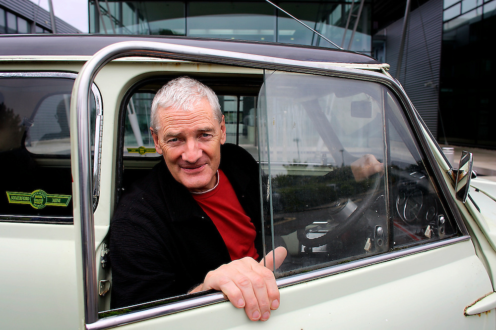 UK ENGLAND WILTSHIRE MALMESBURY 14SEP06 - Inventor and company chairman James Dyson (58) sits in a classic Mini car in front of the Dyson headquarters in Malmesbury, Wiltshire. His company - with its distinctive range of boldly-coloured products - is now said to be Europe's fastest growing manufacturer and has achieved sales of over £3bn worldwide, with £35m profit in 2000.<br />
