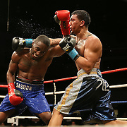 Dashon Johnson (left) fights against Luis Arias during Showtime Televisions ShoBox:The Next Generation boxing match at the Event Center at Turning Stone Resort Casino on Friday, February 28, 2014 in Verona, New York.  (AP Photo/Alex Menendez)