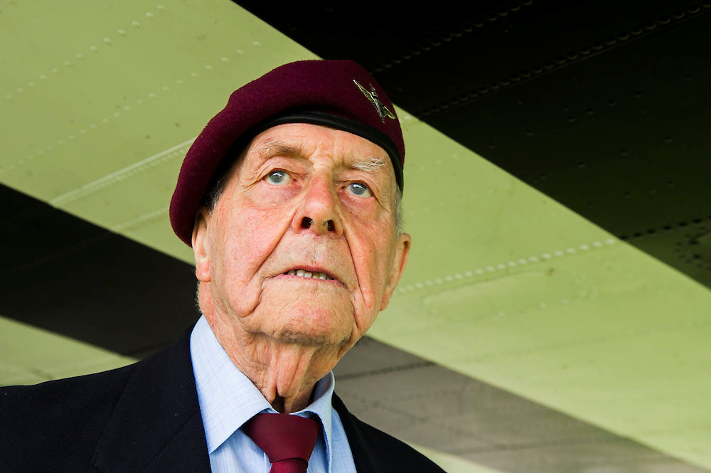 Geoff Patinson, 90, 9 Para. under a dakota with d-day markings. Veterans of the Parachute Regiment at the time of D Day, in the second world war, visit 16 Air Assault Brigade who will be carrying out a drop to commemorate the 70th anniversary next week. Colchester, UK.
