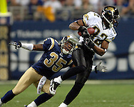 Jacksonville Jaguars wide receiver Jimmy Smith (82) makes a 18-yard catch in front of St. Louis Rams defensive back Corey Ivy (35) in the first quarter at the Edward Jones Dome in St. Louis, Missouri, October 30, 2005.  The Rams beat the Jaguars 24-21.