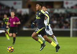 SWANSEA, WALES - Saturday, January 14, 2017: <br /> Arsenal's Alex Iwobi in action against Swansea City during the FA Premier League match at the Liberty Stadium. (Pic by Gwenno Davies/Propaganda)