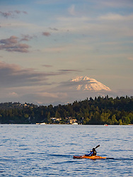 United States, Washington, Bellevue, kayaker on Lake Washington and Mount Rainier