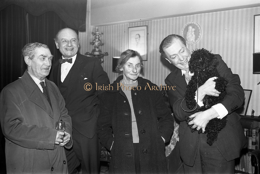 13/02/1964<br /> 02/13/1964<br /> 13 February 1964<br /> Party at the Olympia Theatre, Dublin. At the party (l-r): John Whelan, Cellarman with 49 years service; Leo McCabe; Miss Mary Leddy, Bar manageress of 36 years service and Stanley Gillsley(?).