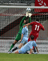 Robert Olejnik saves from Franz Burgmeier.<br /> Vaduz 2 v 0 Falkirk FC at the Rheinpark Stadium for their Europa League second-round qualifier against Vaduz in Liechtenstein.<br /> ©2009 Michael Schofield. All Rights Reserved.