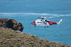© Licensed to London News Pictures. 25/05/2020. Padstow, UK. HM Coast Guard at the scene at Trevose Head, near Padstow, Cornwall where two people have died after getting in to trouble in water along the nearby coastline. Due to Coronavirus (COVID-19) there is currently no RNLI lifeguard service on the beaches in Cornwall, as there would be normally at this time of year. Emergency services including the Search and Rescue helicopter, Air Ambulance, paramedics, police, and coastguard were present at the scene. Photo credit : Tom Nicholson/LNP