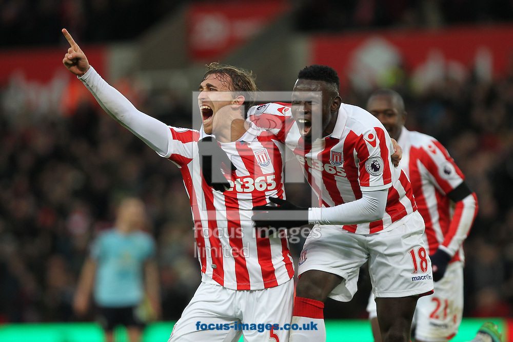 Marc Muniesa of Stoke City celebrates with Mame Biram Diouf after scoring the first goal against Burnley during the Premier League match at the Bet 365 Stadium, Stoke-on-Trent.<br /> Picture by Michael Sedgwick/Focus Images Ltd +44 7900 363072<br /> 03/12/2016