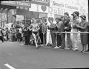 Finish of Dublin City Marathon .25/10/1982  Radio 2, Dublin City Marathon..1982.25.10.1982.10.25.1982.25th October 1982..The Radio 2 sponsored Dublin City Marathon finish at St Stephens Green Dublin..The overall winners were:Men, Gerry Kiernan,Listowel, Kerry. Women, Debbie Mueller,U.S.A. and the first wheelchair competitor Michael O'Rourke..Not far behind the leaders Mick Walshe,Cork sprints across the finish line.