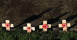 © Licensed to London News Pictures. <br /> 16/12/2014. <br /> <br /> Hartlepool, United Kingdom<br /> <br /> Wooden crosses are planted in the grass during an event to commemorate the bombardment of Hartlepool by German warships during World War One. During the bombardment 130 civilians were killed and more than 500 were wounded. The Headland's Heugh Gun Battery returned fire in what was the only battle to be fought on British soil during World War One, and one of the Battery's soldiers, Theo Jones of the Durham Light Infantry, became the first British soldier to be killed by enemy action on home ground in the war.<br /> <br /> Photo credit : Ian Forsyth/LNP