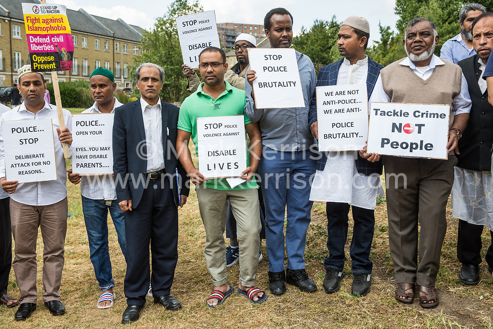 London, UK. 12 July, 2019. Members of the local community in Poplar protest after Friday prayers close to the site where Youness Bentahar, aged 38, was violently arrested by Metropolitan Police officers on 10th July following a 5-stage warning. The incident, during which Mr Bentahar appeared to be having a seizure, has since been referred to the Metropolitan Police's Central East Command Professional Standards Unit after a video of the arrest went viral on social media. Mr Bentahar was filmed being struck with handcuffs and pinned down by police officers after he had stopped on a single yellow line with a disabled badge displayed and ignored the five-stage warning.